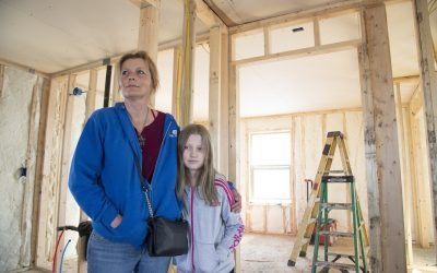 After a Washington state town burnt down, a resident opens her donated home to neighbors